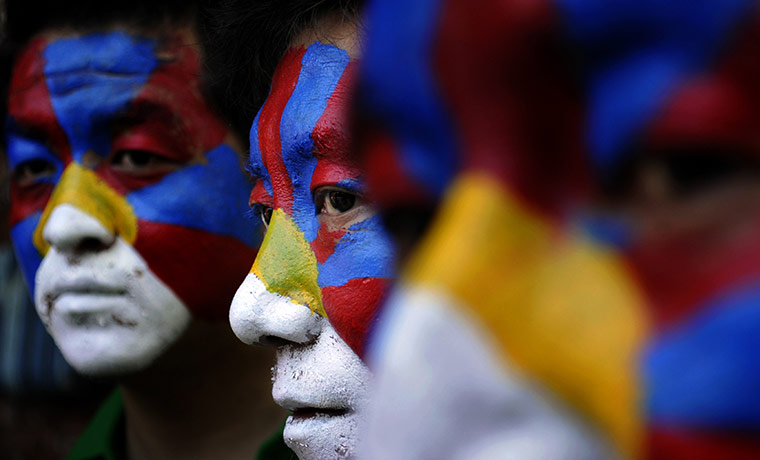 New-Delhi-India-Tibetan-exiles-with-faces-painted-in-the-Tibetan-flag-participate-in-a-rally
